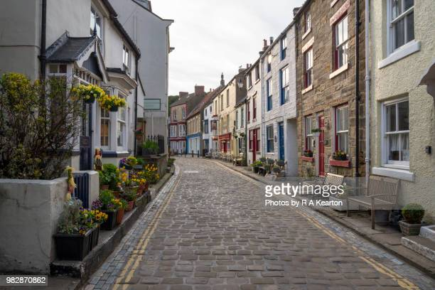 main street in the village of staithes, north yorkshire, england - north yorkshire stock pictures, royalty-free photos & images