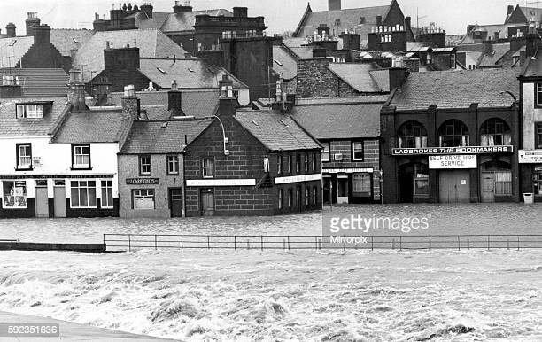 Main street in Whitesands, Dumfries, flooded when the Rover Nith burst its banks and swirled into shops, houses and pubs, 30th January 1974.