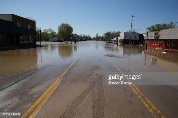 Main street is flooded after water from the Tittabawassee River breached a nearby dam on May 20, 2020 in Sanford, Michigan. Thousands of residents...