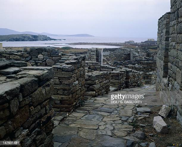 Main street of the theatre district looking towards the Port in Delos Cyclades Islands Greece Greek civilization