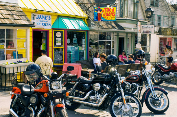 A main street of Woodstock, NY, showing stores and parked motorcycles.