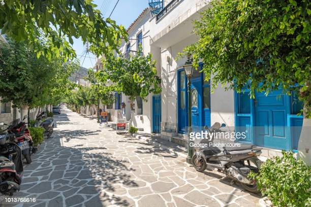 main street on the island of fournoi, greece - samos stock photos and pictures
