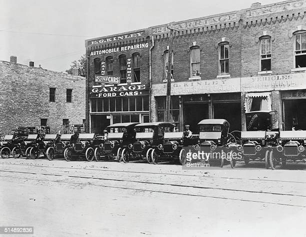 Main Street Topeka Kansas showing Ford Motor Car sales office and garage with Model T's lined up along curb