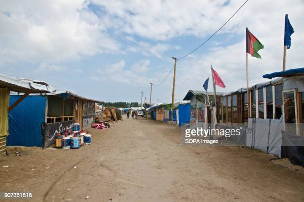 A main thoroughfare in the migrant camp in Calais where thousands were living in the hopes of getting to the UK before it was demolished The Calais...