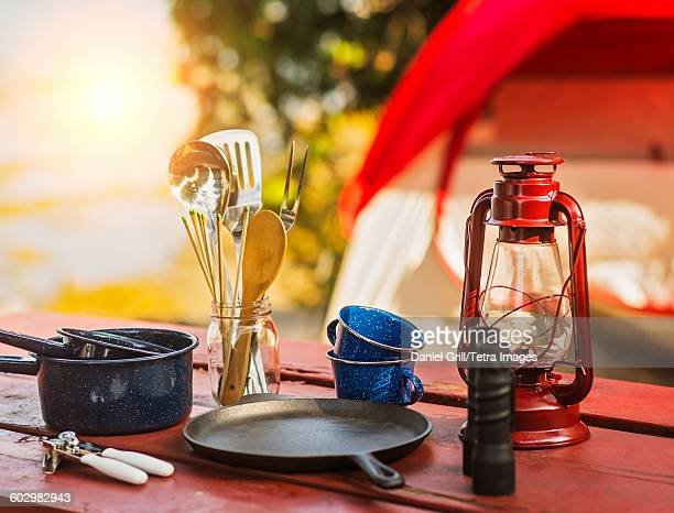 USA, Maine, Acadia National Park, Oil lamp, binoculars and cooking utensils on picnic table