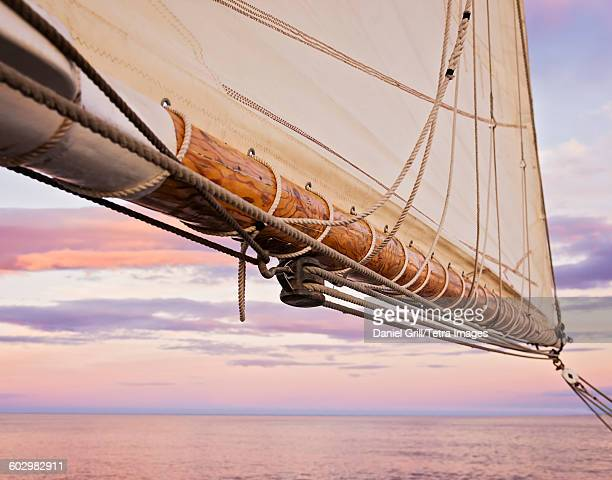 USA, Maine, Camden, Close-up of sail and ropes against sunset sky