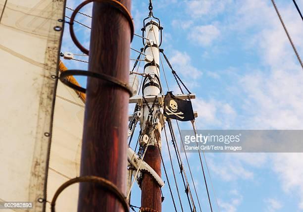 USA, Maine, Camden, Close-up of sailboats mast and pirate flag