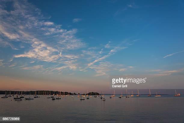 USA, Maine, Camden, Sailboats at sunset