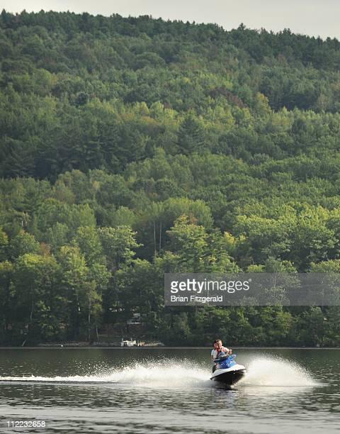 Maine Camp Life : A couple jet skis on Crystal Lake near Harrison, Maine.