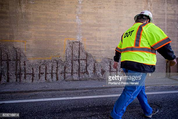Maine DOT press secretary Ted Talbot walks off the Route 1 viaduct in Bath past some corrosion on the bridge supporting High Street Thursday April 21...