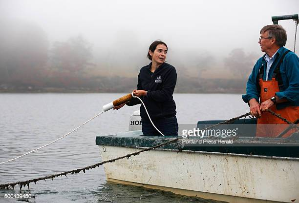 Maine Fresh Sea Farms which grows sea vegetables on Clark's Cove in Walpole Seth Barker of Maine Fresh Sea Farms holds a guide line while Sarah...