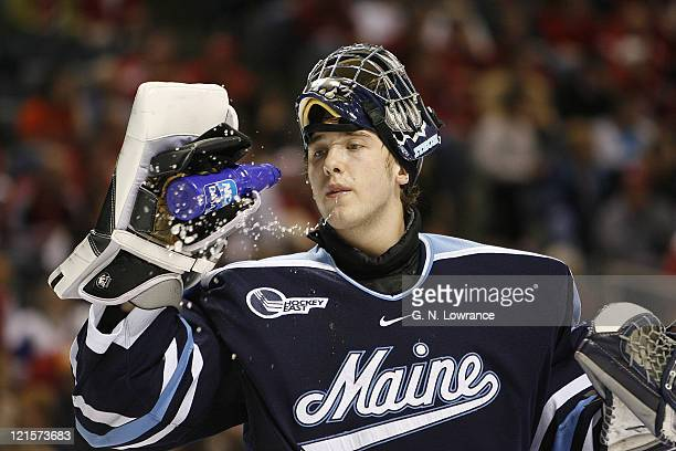 Maine goalie Ben Bishop has a drink during 1st-period action versus Wisconsin in the semi-finals of the NCAA frozen four at the Bradley Center in...