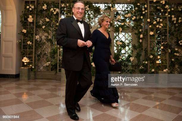 Maine Gov Paul LePage and his wife Lauren arrive at the White House for a state dinner April 24 2018 in Washington DC President Donald Trump is...