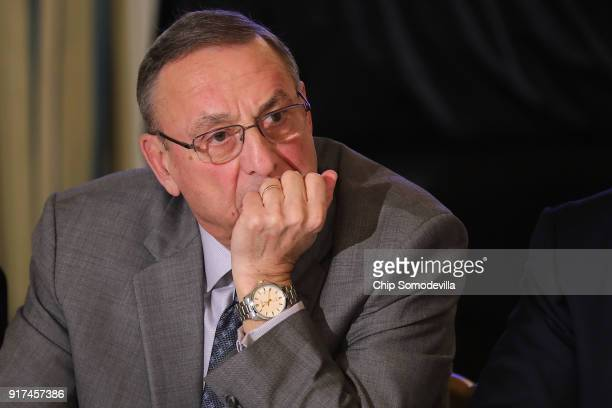 Maine Governor Paul LePage listens to US President Donald Trump during meeting with state and local officials to unveil the Trump administration's...