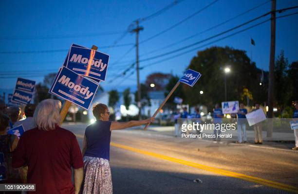 Maine gubernatorial debate Supporters of republican candidate Shawn Moody wave signs before the debate held at the University of New England on...