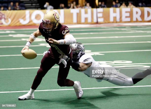 Maine Mammoths arena football team home opener at Cross Arena Jonathan Bane of Maine is tackled by Cedric Poole of Carolina on a quarterback keeper