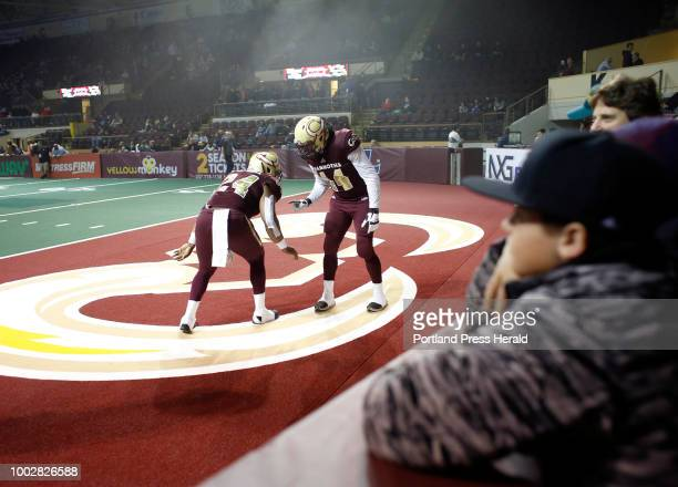 Maine Mammoths arena football team home opener at Cross Arena Desmond Maxwell left and Niko Sierra of Maine go through pregame rituals as fans get an...