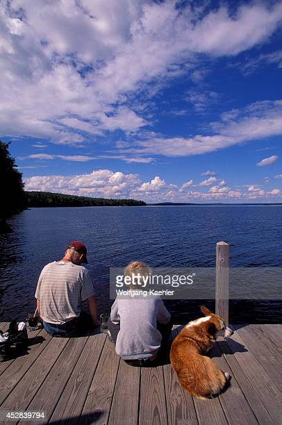 USA Maine Moosehead Lake Rockwood The Birches Resort Jetty Children with dog