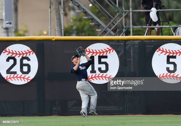 Maine outfielder Brandon Vicens catches a fly ball during a college baseball game between the University of Maine Black Bears and the University of...
