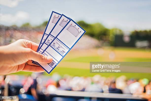 usa, maine, portland, close-up of hand holding tickets at stadium - baseball sport stock pictures, royalty-free photos & images