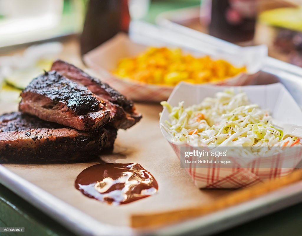 USA, Maine, Portland, Grilled meat and salad : Stock Photo
