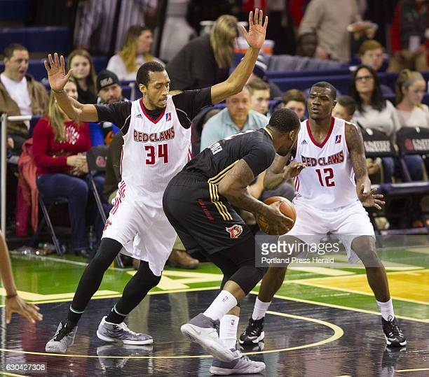 Maine Red Claws center Asauhn DixonTatum and forward Jalen Jones double team Erie Bayhawks forward Cliff Alexander during D League action at the...