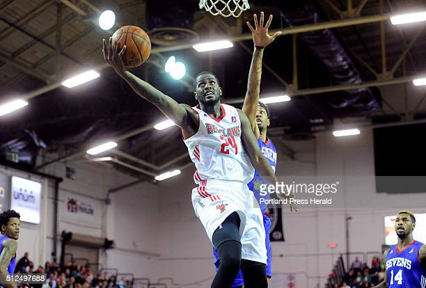 Maine Red Claws take on Delaware 87ers at the Expo on Thursday February 25 2016 Omari Johnson of Maine lays the ball up after driving past Christian...