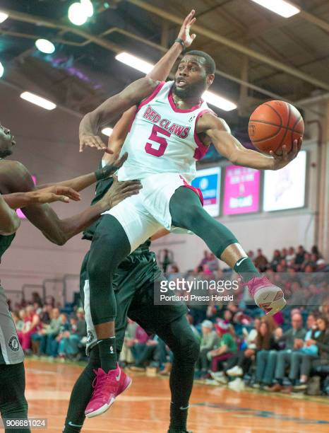Maine Red Claws vs Austin Spurs in G League basketball at the Portland Expo Maine's Kadeem Allen looks for a teammate to pass to on a drive to the...