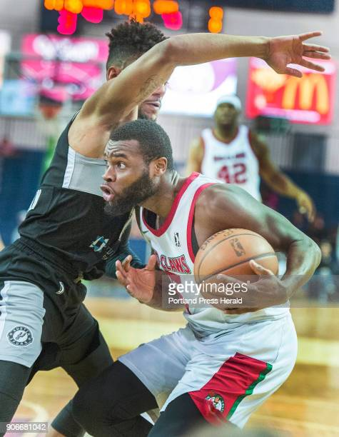 Maine Red Claws vs Austin Spurs in G League basketball at the Portland Expo Red Claw guard Kadeem Allen drives past Austin's Oliver Hanlan on a...