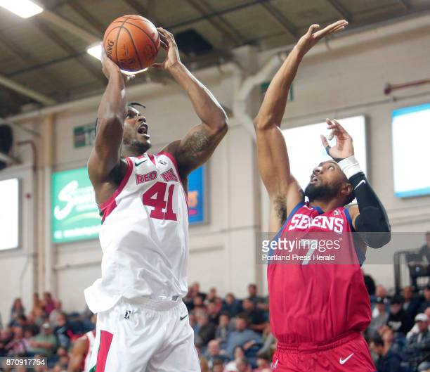 Maine Red Claws vs Delaware 87ers Devin Williams of Maine puts up a shot over Shane Edwards of Delaware in the third period