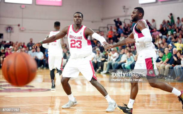 Maine Red Claws vs Delaware 87ers Jabari Bird of Maine slaps hands with teammate Kadeem Allen after Allen made an assist to him in the third period