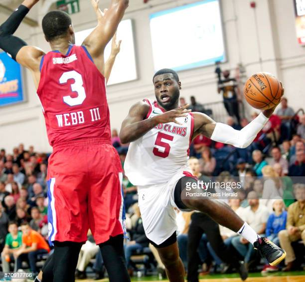 Maine Red Claws vs Delaware 87ers Kadeem Allen of Maine dishes the ball around James Webb III of Delaware after driving to the basket in the third...
