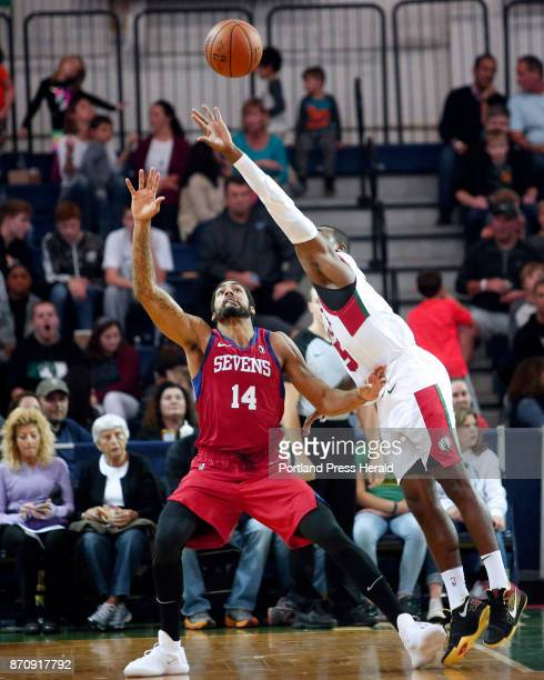 Maine Red Claws vs Delaware 87ers Kadeem Allen of Maine reaches to tap a pass away from James Michael McAdoo of Delaware in the third period