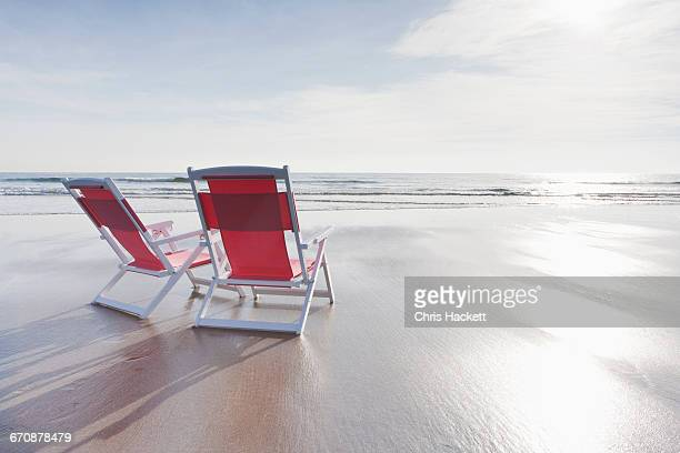 Maine, Red deckchairs on empty beach