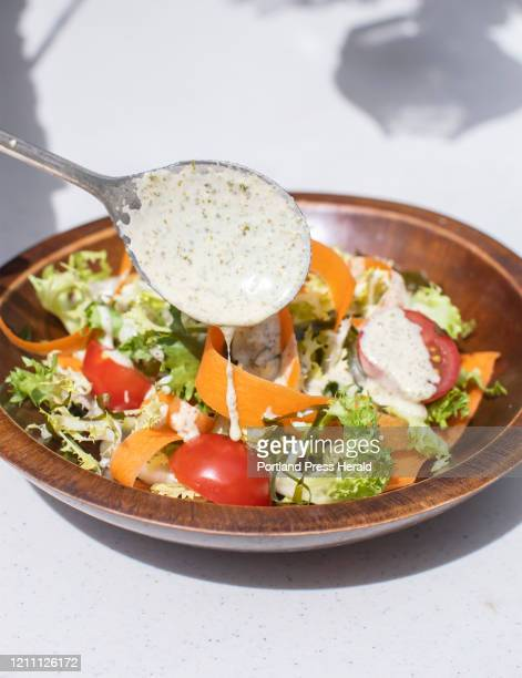 Maine seaweed and tahini salad dressing is poured over a winter greens salad on Thursday, April 16, 2020.