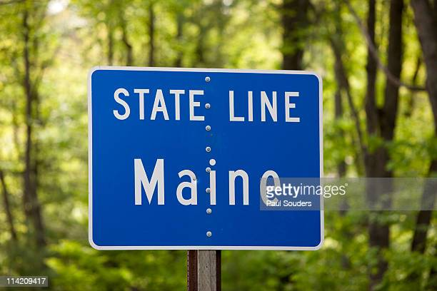 maine state line road sign - us state border stock photos and pictures
