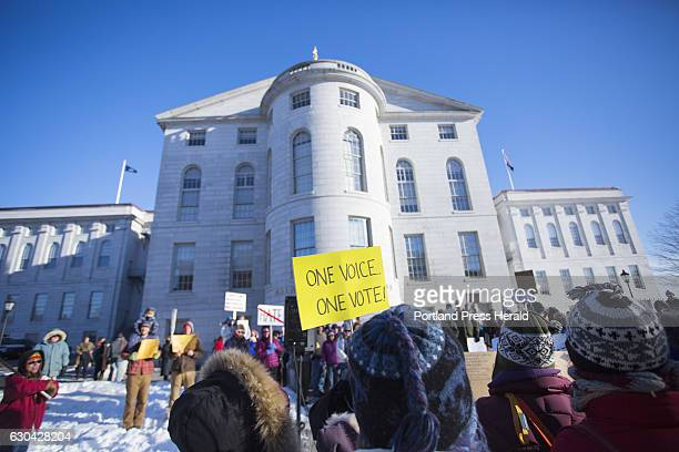Maine's Electoral College electors cast their votes for President of the United States in Augusta on Monday, Dec. 19, 2016. A large crowd of...