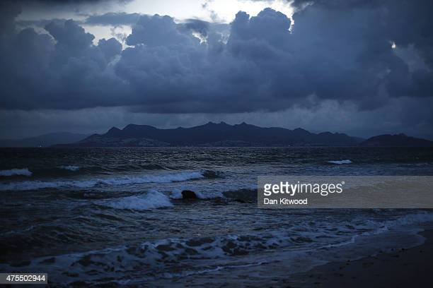 Mainland Turkey is seen at Dawn on May 29 2015 in Kos Greece Migrants are continuing to arrive on the Greek Island of Kos from Turkey who's shoreline...