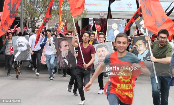 Mainly students workers and trade unionists hold images of Marxist leaders flags and shout slogans during a May Day or Labour Day rally in Ankara on...