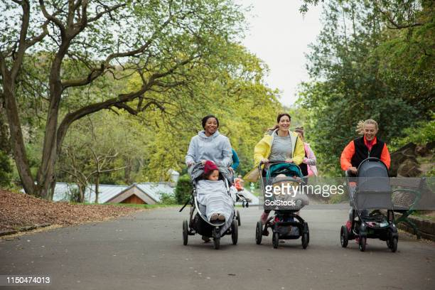 maintaining an active lifestyle - pushchair stock pictures, royalty-free photos & images