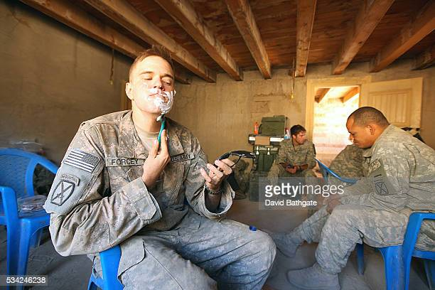 Maintaining Army standards a soldier from Charlie Company the US Army's 10th Mountain Division treats himself to a morning shave at Firebase...