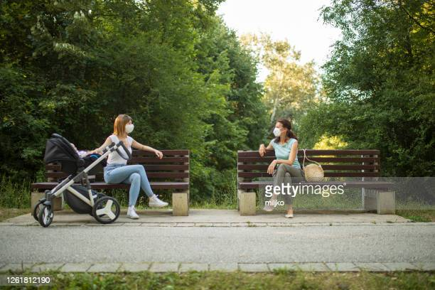 maintaining social distance in a public place - carriage stock pictures, royalty-free photos & images