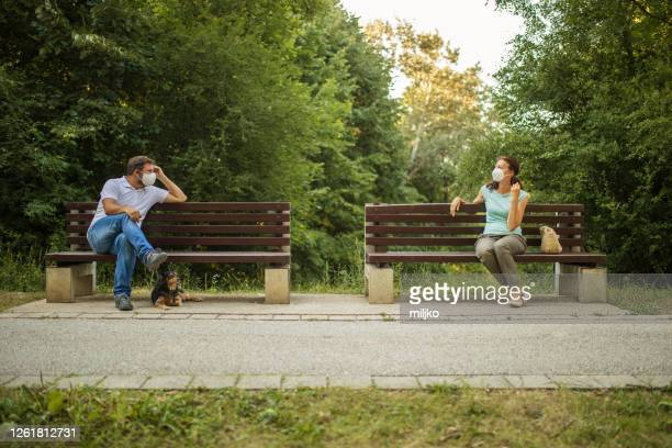 maintaining social distance in a public place - bench stock pictures, royalty-free photos & images