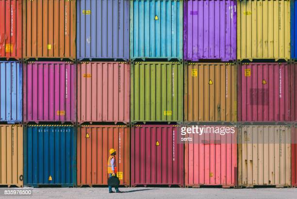 maintanence worker working with cargo containers - commercial dock stock pictures, royalty-free photos & images