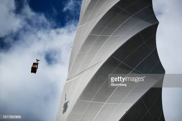 A maintenance cradle hangs beside the fiberglass membrane of the 246 meter tall Thyssenkrupp Elevator AG test tower in Rottweill Germany on Tuesday...