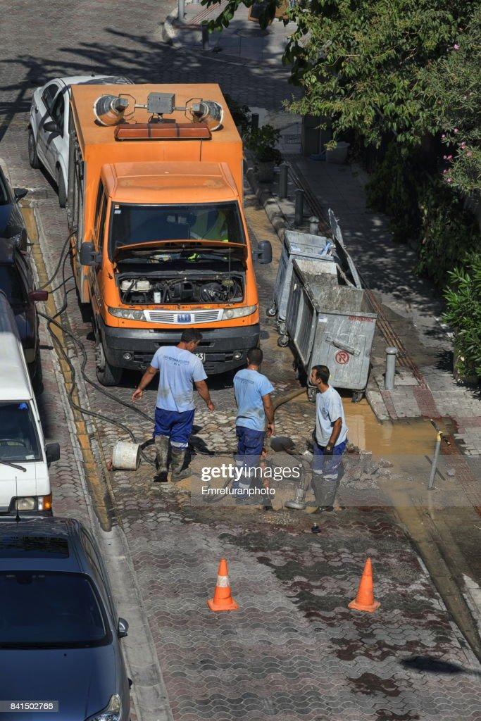 Maintenance crew fixing a broken water line in Izmir. : Stock Photo