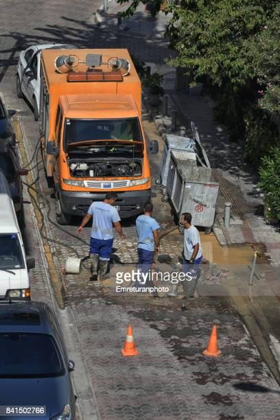 maintenance crew fixing a broken water line in izmir. - emreturanphoto stock pictures, royalty-free photos & images