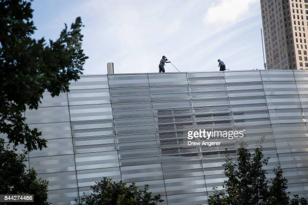 A maintenance crew works on the roof of the National September 11 Museum September 8 2017 in New York City New York City is preparing to mark the...