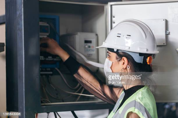 maintenance engineer checking fusebox - electrical panel box stock pictures, royalty-free photos & images