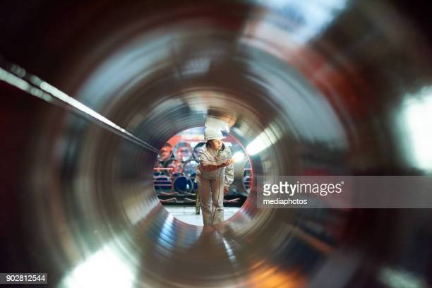 maintenance engineer examining quality of tube - making stock pictures, royalty-free photos & images